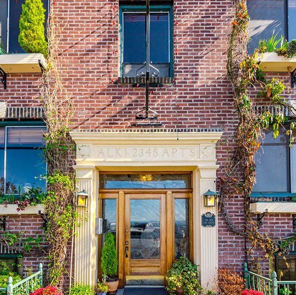 Alki Apartments brick facade, an apartment managed by Lori Gill & Associates